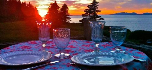 Great Duck Island House | Porch table setting and sunset beyond