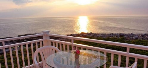 Great Duck Island House | View off porch at sunset