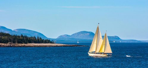 Great Duck Island House | Sailboat off the shoreline