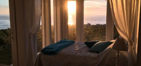 Great Duck Island House | Interior | Bed at sunset